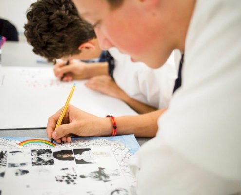 Image of two students drawing.